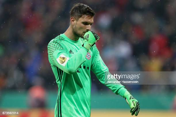 Sven Ullreich of Muenchen reacts during the DFB Cup semi final match between FC Bayern Muenchen and Borussia Dortmund at Allianz Arena on April 26...