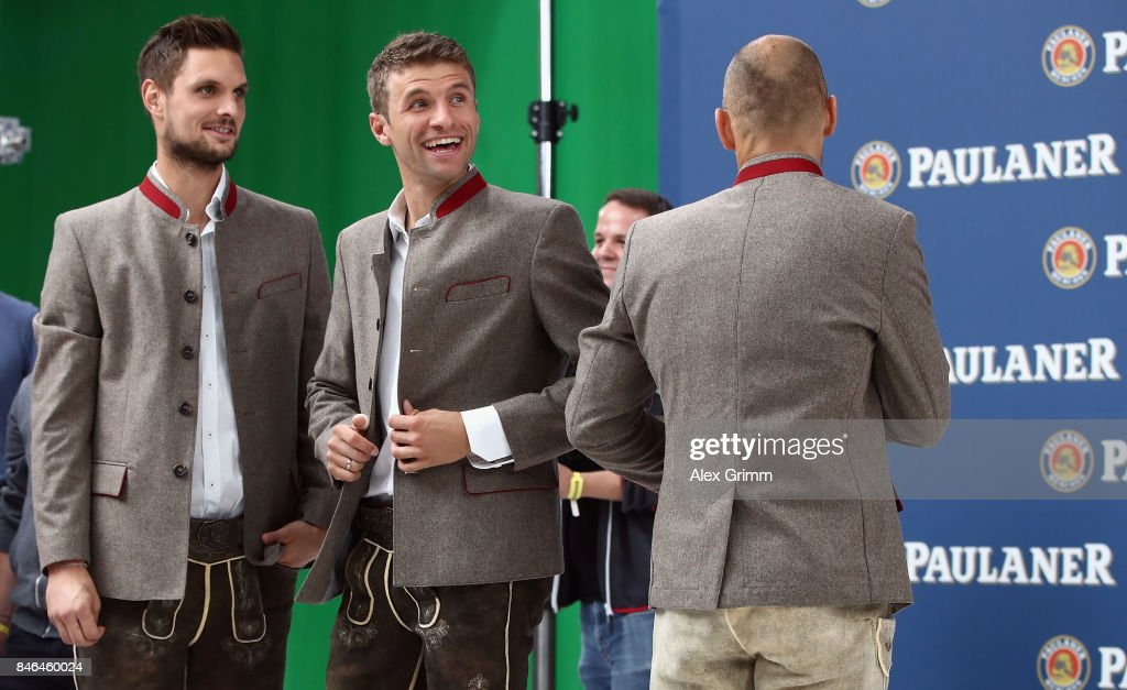 Sven Ulreich and Thomas Mueller attend the FC Bayern Muenchen Paulaner photo shoot in traditional Bavarian lederhosen on September 13, 2017 in Munich, Germany.