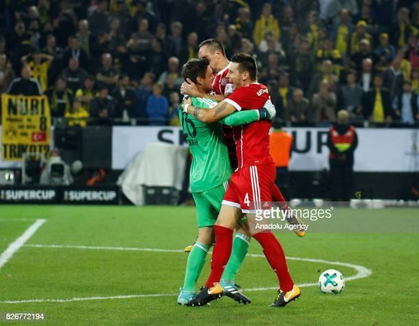 Sven Ulreich Franck Ribery and Niklas Suele of Bayern Munich celebrate after winning DFL Super Cup 2017 final match between Borussia Dortmund and...