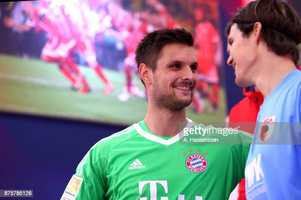 Sven Ulreich keeper of FC Bayern Muenchen talks to Marwin Hitz keeper of Augsburg at the players tunnel prior to the Bundesliga match between FC...