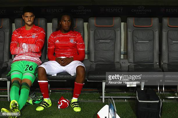 Sven Ulreich keeper of Muenchen and his team mate Renato Sanches take place on the team bench during during the UEFA Champions League Group D match...