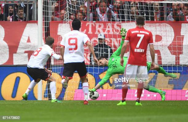 Sven Ulreich of Bayern Muenchen can not save a penalty shot by Daniel Brosinski of 1 FSV Mainz 05 during the Bundesliga match between Bayern Muenchen...