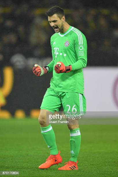 Sven Ulreich of Bayern Muenchen celebrates the third goal for Muenchen by Robert Lewandowski of Bayern Muenchen to make it 03 during the Bundesliga...
