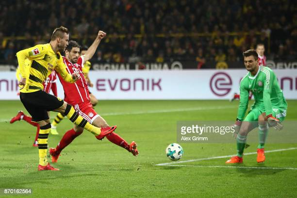 Sven Ulreich of Bayern Muenchen saves against Andrej Yarmolenko of Dortmund during the Bundesliga match between Borussia Dortmund and FC Bayern...