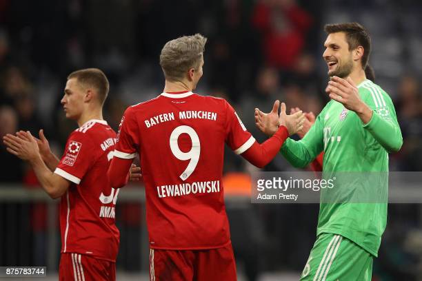 Sven Ulreich of Bayern Muenchen shakes hands with Robert Lewandowski of Bayern Muenchen after the Bundesliga match between FC Bayern Muenchen and FC...