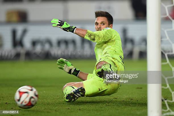 Sven Ulreich of Stuttgart receives the first goal by penalty shot of Paul Verhaegh of Ausgburg during the Bundesliga match between VfB Stuttgart and...