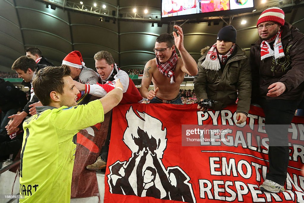 <a gi-track='captionPersonalityLinkClicked' href=/galleries/search?phrase=Sven+Ulreich&family=editorial&specificpeople=4877030 ng-click='$event.stopPropagation()'>Sven Ulreich</a> of Stuttgart shakes hands with fans after the DFB cup round of sixteen match between VfB Stuttgart and 1.FC Koeln at Mercedes-Benz Arena on December 19, 2012 in Stuttgart, Germany.