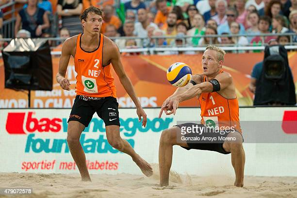 Sven Vismans from The Netherlands bumps the ball close to his teammate Wessel Keemink during the FIVB Beach Volleyball World Championships male match...