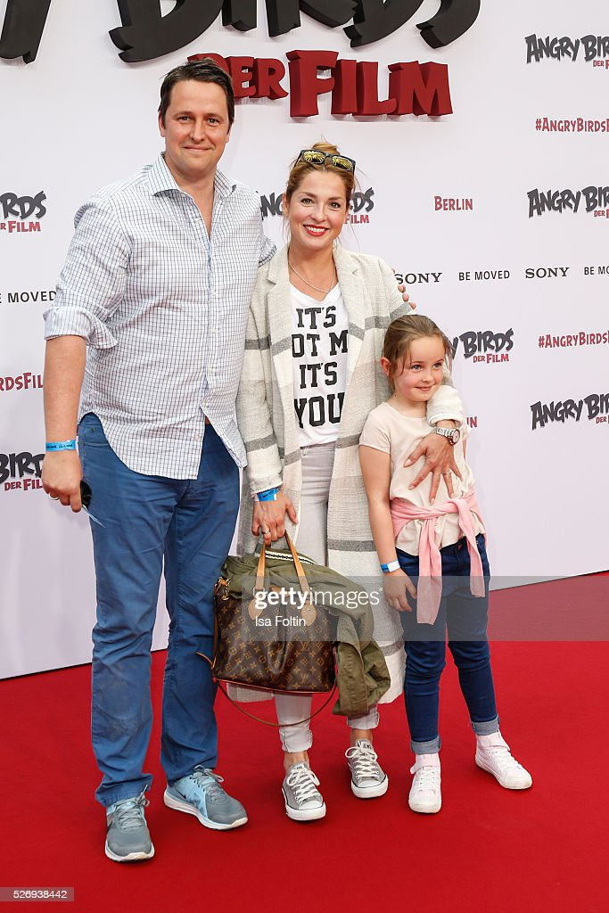 Sven Wedig and Maria Wedig with their daughter Leni Wedig attend the Berlin premiere of the film 'Angry Birds - Der Film' at CineStar on May 1, 2016 in Berlin, Germany.
