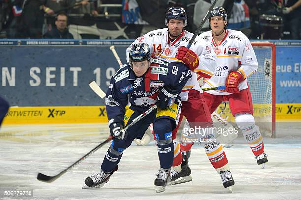 Sven Ziegler of the Eisbaeren Berlin and Norm Milley of the Duesseldorfer EG during the DEL game between the Eisbaeren Berlin and Duesseldorfer EG on...