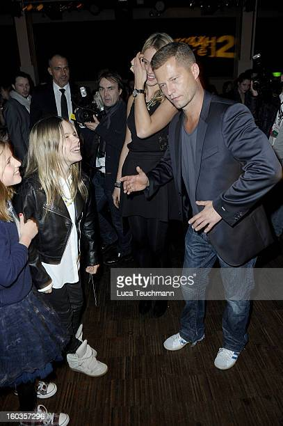 Svenja Holtmann Til Schweiger dances with his daughter Emma and Paula at the after show party to 'Kokowaeaeh 2' Germany Premiere at Astra on January...