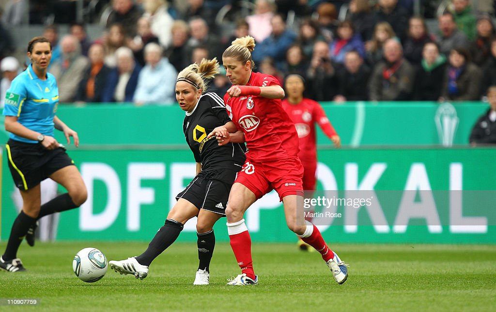 Svenja Huth (L) of Frankfurt and Bianca Schmidt (R) of Potsdam battle for the ball during the DFB Women's Cup final match between 1. FFC Frankfurt and Turbine Potsdam at RheinEnergie stadium on March 26, 2011 in Cologne, Germany.