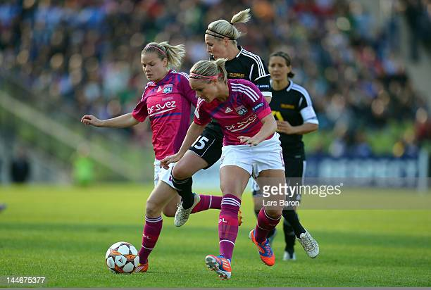 Svenja Huth of Frankfurt is challenged by Eugenie Le Sommer and Amandine Henry of Olympique Lyonnais during the UEFA Women's Champions League Final...