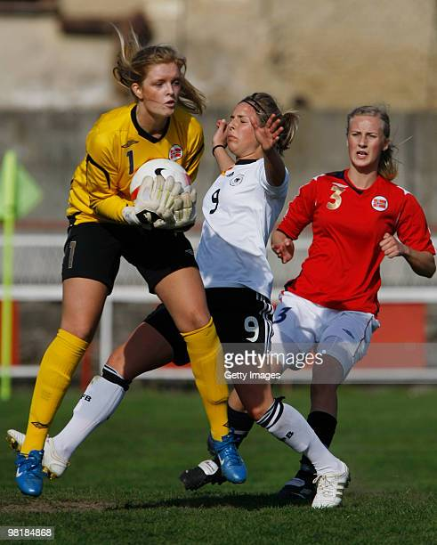 Svenja Huth of Germany battles for the ball with Guro Pettersen and Anja Sonstevold of Norway during the U19 Women International Friendly match...