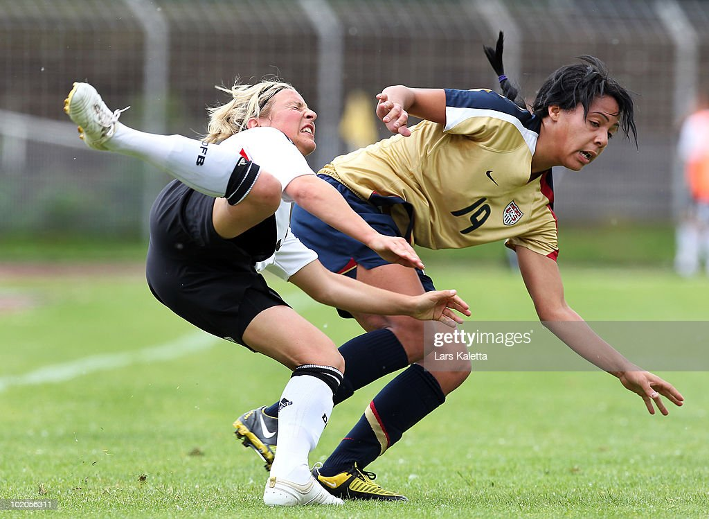 Svenja Huth (L) of Germany challenges Sydney Leroux (R) of USA during the DFB women's U20 match between Germany and USA at the Ludwig-Jahn-Stadion on June 13 2010 in Herford, Gerrmany.