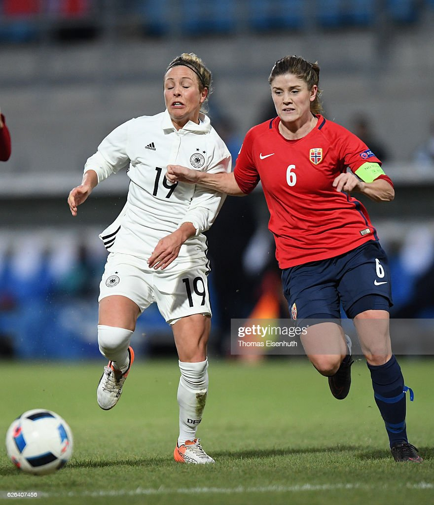 Svenja Huth (L) of Germany is challenged by Maren Mjelde of Norway during the women's international friendly match between Germany and Norway at community4you ARENA on November 29, 2016 in Chemnitz, Germany.