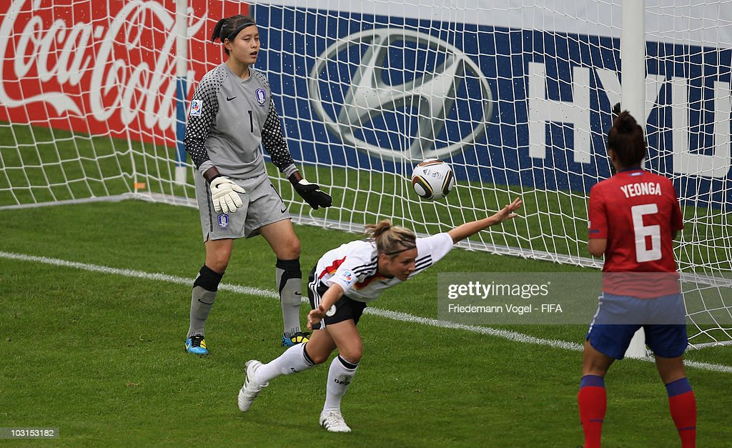 Svenja Huth (C) of Germany scores the first goal during the FIFA U20 Women's World Cup Semi Final match between Germany and South Korea at the FIFA U-20 Women's World Cup stadium on July 29, 2010 in Bochum, Germany.