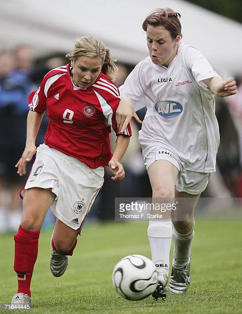 Svenja Huth of Germany tackles Rebecca Lloyd of Wales during the Women's Under 15 match between Germany and Wales on August 14 2006 in Uslar Germany