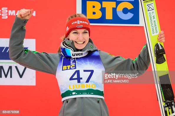 Svenja Wuerth of Germany celebrates after placing third at the Ladies FIS World Cup ski jumping competition in Ljubno on February 12 2017 / AFP /...