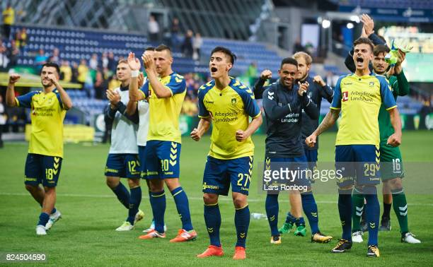Svenn Crone and the players of Brondby IF celebrate after the Danish Alka Superliga match between Brondby IF and Lyngby BK at Brondby Stadion on July...