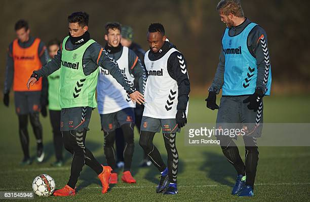 Svenn Crone Lebogang Phiri and Paulus Arajuuri of Brondby IF walks on the pitch during the Brondby IF training session at Brondby Stadion on January...