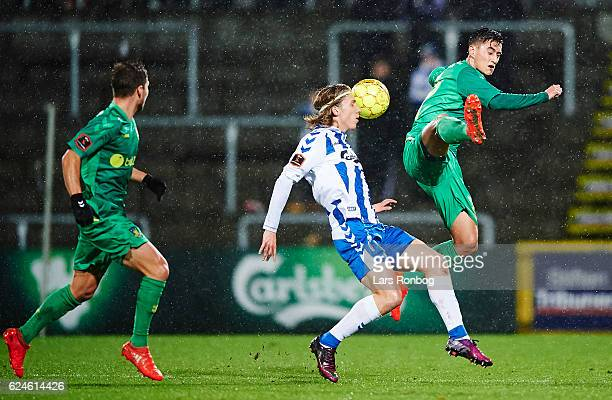 Svenn Crone of Brondby IF and Joan Simun Edmundsson of OB Odense compete for the ball during the Danish Alka Superliga match between OB Odense and...