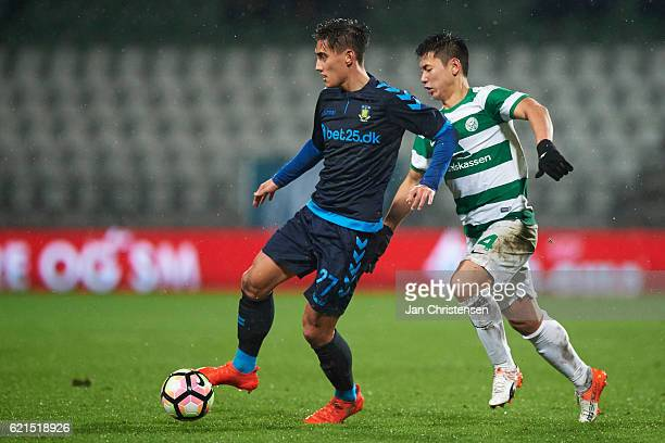 Svenn Crone of Brondby IF and JungBin Park of Viborg FF compete for the ball during the Danish Alka Superliga match between Viborg FF and Brondby IF...