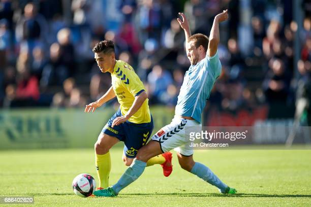 Svenn Crone of Brondby IF and Nicolai Madsen of SonderjyskE compete for the ball during the Danish Alka Superliga match between SonderjyskE and...