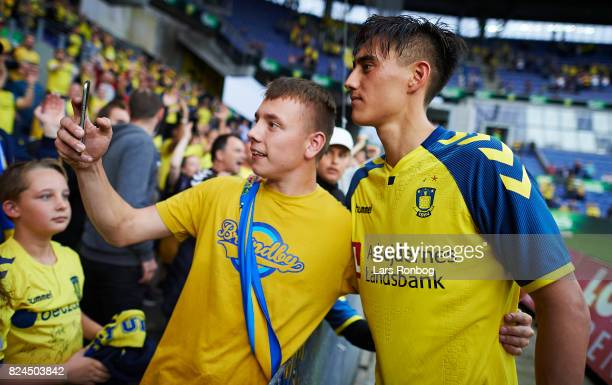 Svenn Crone of Brondby IF has a selfie taken with a fan after the Danish Alka Superliga match between Brondby IF and Lyngby BK at Brondby Stadion on...