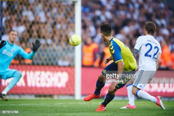 Svenn Crone of Brondby IF with a finish against Goalkeeper Robin Olsen of FC Copenhagen during the Danish Alka Superliga match between Brondby IF and...