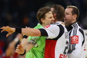 SvenSoeren Christophersen of Germany celebrates the decision goal to play a 2121 draw with Lars Kaufmann and Pascal Hens during the Men's European...