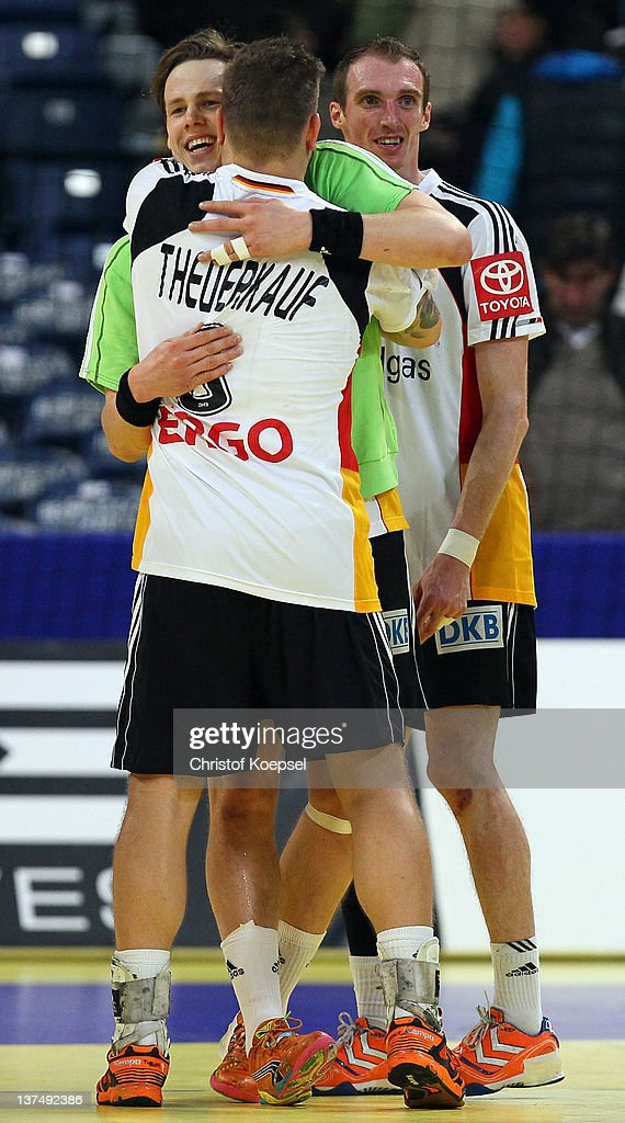 <a gi-track='captionPersonalityLinkClicked' href=/galleries/search?phrase=Sven-Soeren+Christophersen&family=editorial&specificpeople=2366838 ng-click='$event.stopPropagation()'>Sven-Soeren Christophersen</a> of Germany celebrates the decision goal to play a 21-21 draw with Christoph Theuerkauf (L) and <a gi-track='captionPersonalityLinkClicked' href=/galleries/search?phrase=Holger+Glandorf&family=editorial&specificpeople=687256 ng-click='$event.stopPropagation()'>Holger Glandorf</a> after the Men's European Handball Championship second round group one match between Serbia anhd Germany at Beogradska Arena on January 21, 2012 in Belgrade, Serbia.