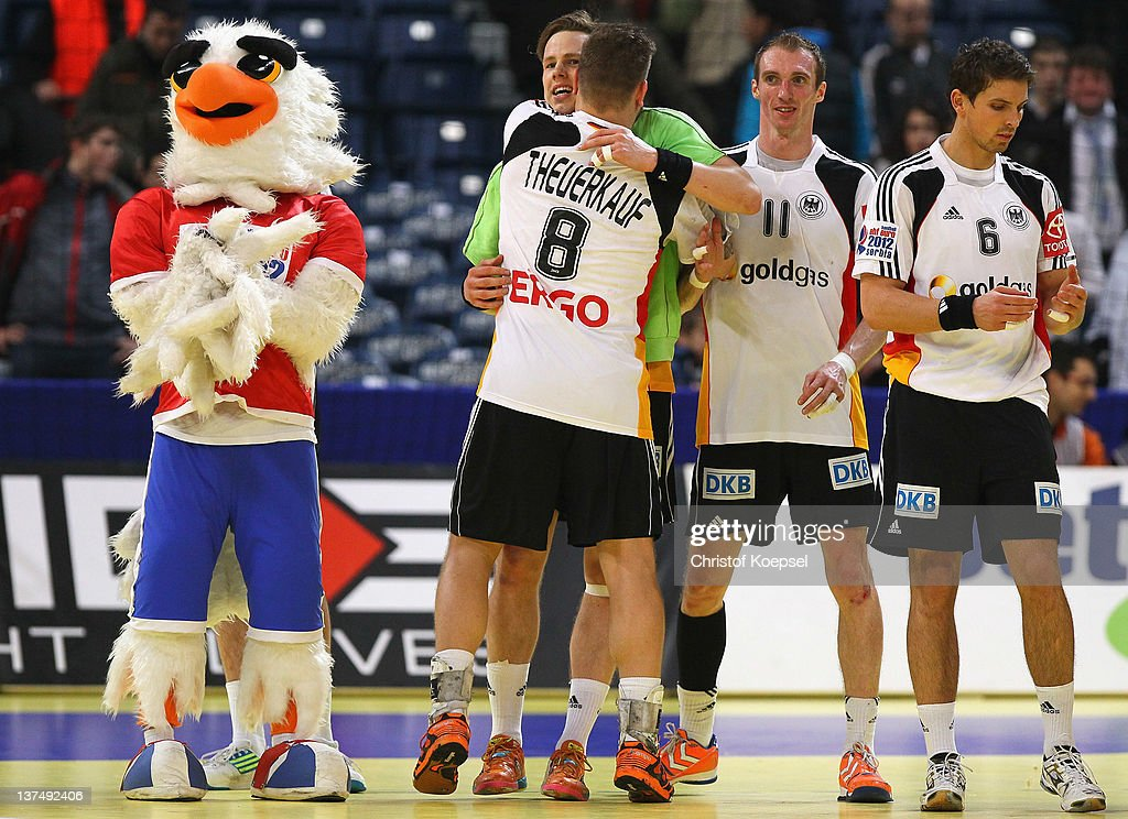 <a gi-track='captionPersonalityLinkClicked' href=/galleries/search?phrase=Sven-Soeren+Christophersen&family=editorial&specificpeople=2366838 ng-click='$event.stopPropagation()'>Sven-Soeren Christophersen</a> of Germany celebrates the decision goal to play a 21-21 draw with Christoph Theuerkauf (L, <a gi-track='captionPersonalityLinkClicked' href=/galleries/search?phrase=Holger+Glandorf&family=editorial&specificpeople=687256 ng-click='$event.stopPropagation()'>Holger Glandorf</a> and Adrian Pfahl after the Men's European Handball Championship second round group one match between Serbia anhd Germany at Beogradska Arena on January 21, 2012 in Belgrade, Serbia.