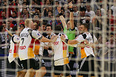 SvenSoeren Christophersen of Germany celebrates the decision goal to play a 2121 draw withz his team after the Men's European Handball Championship...