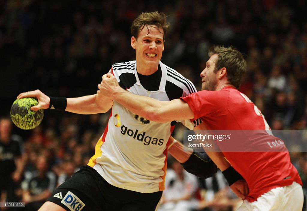 <a gi-track='captionPersonalityLinkClicked' href=/galleries/search?phrase=Sven-Soeren+Christophersen&family=editorial&specificpeople=2366838 ng-click='$event.stopPropagation()'>Sven-Soeren Christophersen</a> of Germany is challenged by <a gi-track='captionPersonalityLinkClicked' href=/galleries/search?phrase=Kasper+Nielsen&family=editorial&specificpeople=663024 ng-click='$event.stopPropagation()'>Kasper Nielsen</a> of Denmark during the Handball international friendly match between Denmark and Germany at Jyske Bank Boxen on April 6, 2012 in Herning, Denmark.