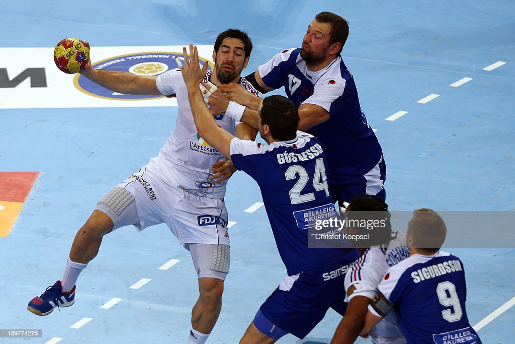 Sverre Jakobsson (3rd L) and Olafur Gustafsson (2nd L) of Iceland and Gudjon Sigurdsson of Iceland (R) defend against <a gi-track='captionPersonalityLinkClicked' href=/galleries/search?phrase=Nikola+Karabatic&family=editorial&specificpeople=620415 ng-click='$event.stopPropagation()'>Nikola Karabatic</a> of France (L) during the round of sixteen match between Iceland and France at Palau Sant Jordi on January 20, 2013 in Barcelona, Spain.