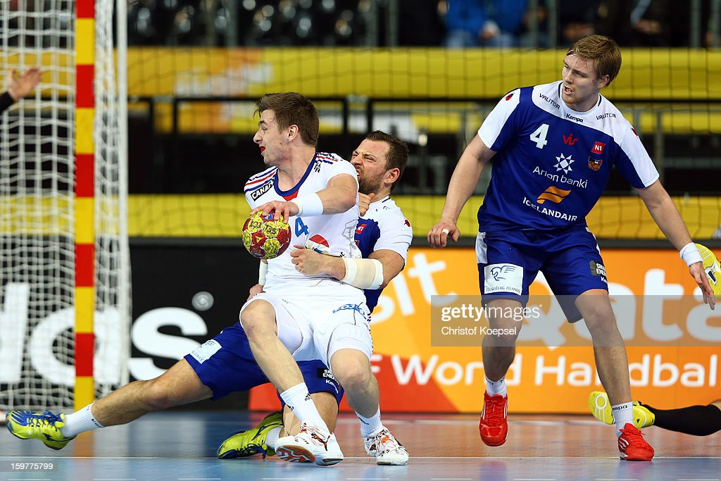 Sverre Jakobsson of Iceland (C) defends against Yavier Barachet of France (L) during the round of sixteen match between Iceland and France at Palau Sant Jordi on January 20, 2013 in Barcelona, Spain.