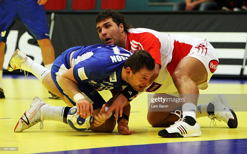 Sverre Jakobsson of Iceland in action with Gyula Gal of Hungary during the Men's Handball European Championship main round Group II match between Hungary and Iceland at Trondheim Spektrum on January 23, 2008 in Trondheim, Norway.
