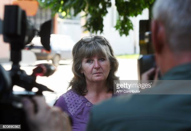 Svetlana Ageyeva the mother of Viktor Ageyev a Russian detained in the wartorn Ukrainian east speaks to the press after meeting with her son as he...