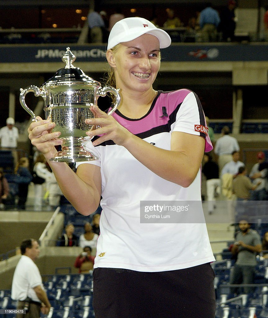 <a gi-track='captionPersonalityLinkClicked' href=/galleries/search?phrase=Svetlana+Kuznetsova&family=editorial&specificpeople=167249 ng-click='$event.stopPropagation()'>Svetlana Kuznetsova</a> holds the championship trophy after her women's final victory at the U.S. Open over <a gi-track='captionPersonalityLinkClicked' href=/galleries/search?phrase=Elena+Dementieva&family=editorial&specificpeople=202670 ng-click='$event.stopPropagation()'>Elena Dementieva</a>. Kuznetsova won in straight sets 6-3, 7-5.