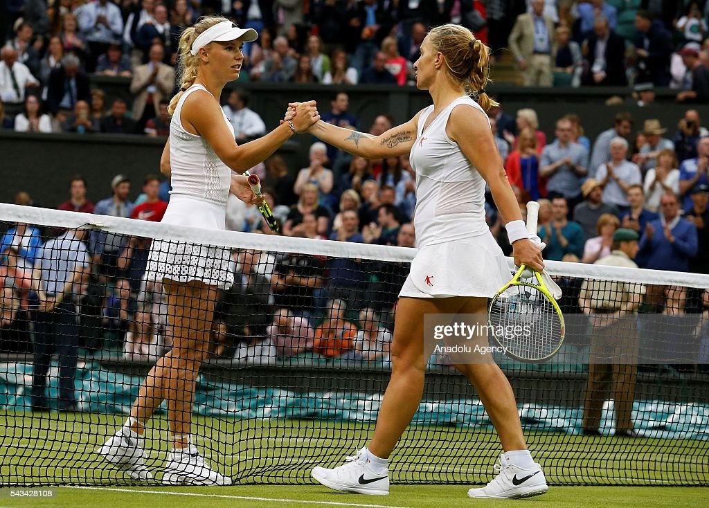 Svetlana Kuznetsova (R) of Russia and Caroline Wozniacki of Denmark (L) are seen after the Women's Singles on day two of the 2016 Wimbledon Championships at the All England Lawn and Croquet Club in London, United Kingdom on June 28, 2016.