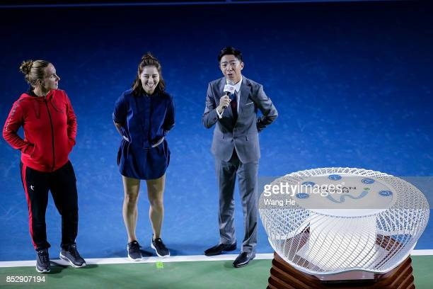Svetlana Kuznetsova of Russia and Li Na of China press the button for the opening ceremony of 2017 Wuhan Open on September 24 2017 in Wuhan China