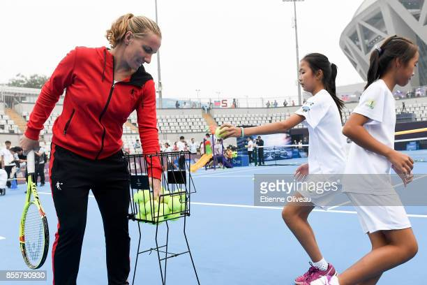 Svetlana Kuznetsova of Russia attends the MercedesBenz Kids event during day 1 of the 2017 China Open at the China National Tennis Centre on...