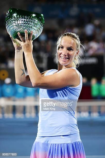 Svetlana Kuznetsova of Russia celebrates and holds aloft the winners trophy after winning the final match against Monica Puig of Puerto Rico day six...