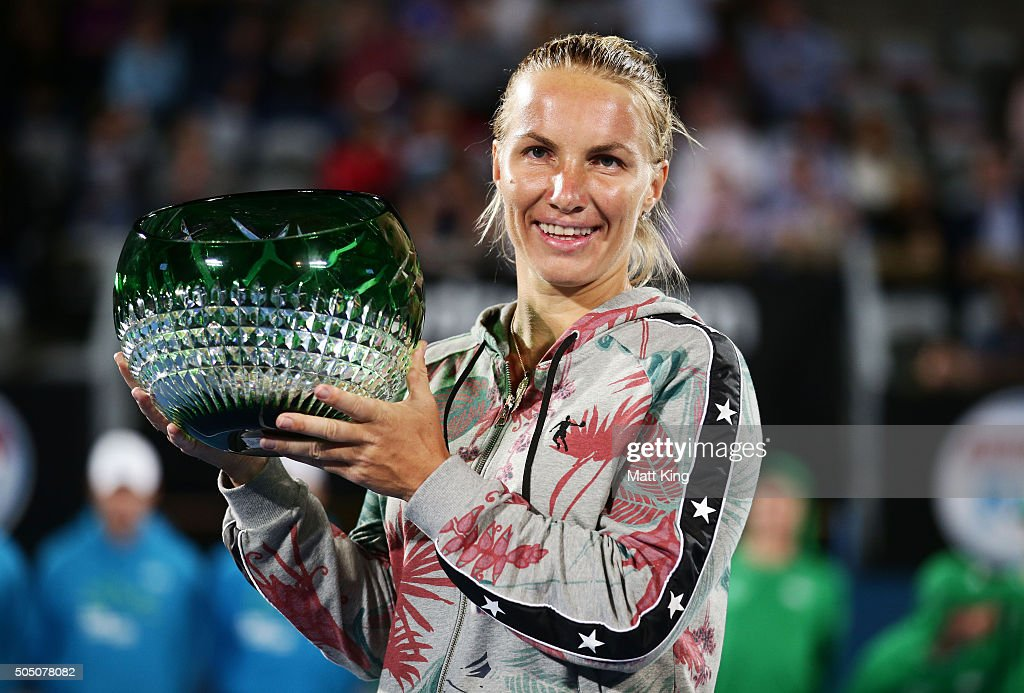 <a gi-track='captionPersonalityLinkClicked' href=/galleries/search?phrase=Svetlana+Kuznetsova&family=editorial&specificpeople=167249 ng-click='$event.stopPropagation()'>Svetlana Kuznetsova</a> of Russia celebrates and holds aloft the winners trophy after winning the final match against Monica Puig of Puerto Rico day six of the 2016 Sydney International at Sydney Olympic Park Tennis Centre on January 15, 2016 in Sydney, Australia.