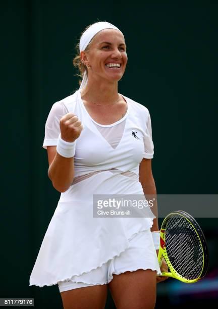 Svetlana Kuznetsova of Russia celebrates match point and victory during the Ladies Singles fourth round match against Agnieszka Radwanska of Poland...