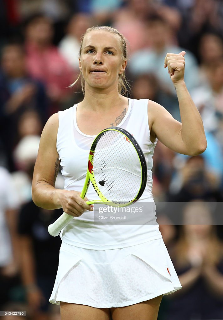 <a gi-track='captionPersonalityLinkClicked' href=/galleries/search?phrase=Svetlana+Kuznetsova&family=editorial&specificpeople=167249 ng-click='$event.stopPropagation()'>Svetlana Kuznetsova</a> of Russia celebrates victory during the Ladies Singles first round match against Caroline Wozniacki of Denmark on day two of the Wimbledon Lawn Tennis Championships at the All England Lawn Tennis and Croquet Club on June 28, 2016 in London, England.