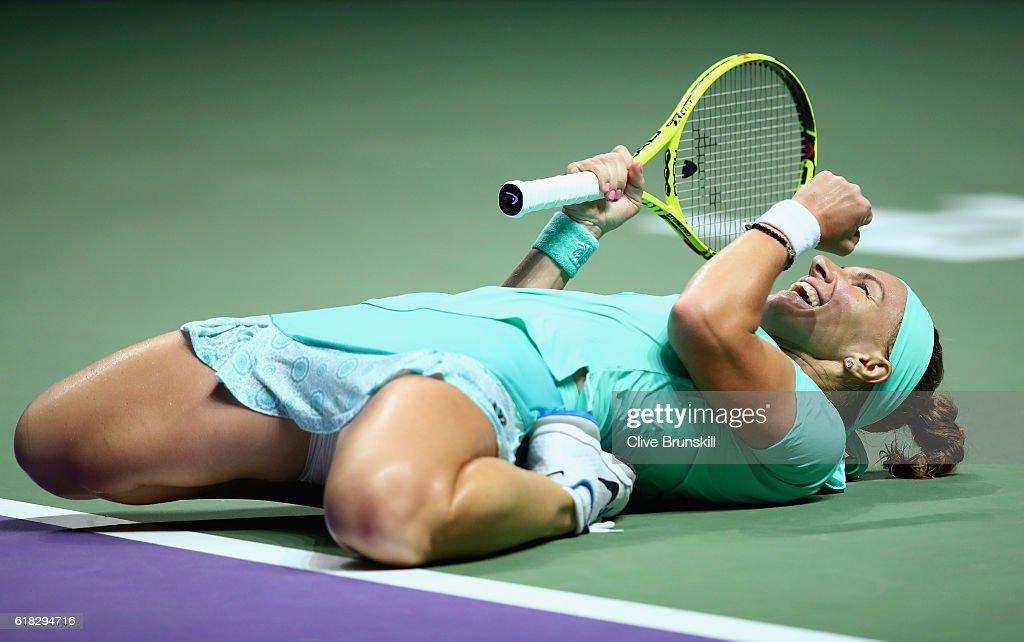 Svetlana Kuznetsova of Russia celebrates victory in her singles match against Karolina Pliskova of Czech Republic during day 4 of the BNP Paribas WTA Finals Singapore at Singapore Sports Hub on October 26, 2016 in Singapore.