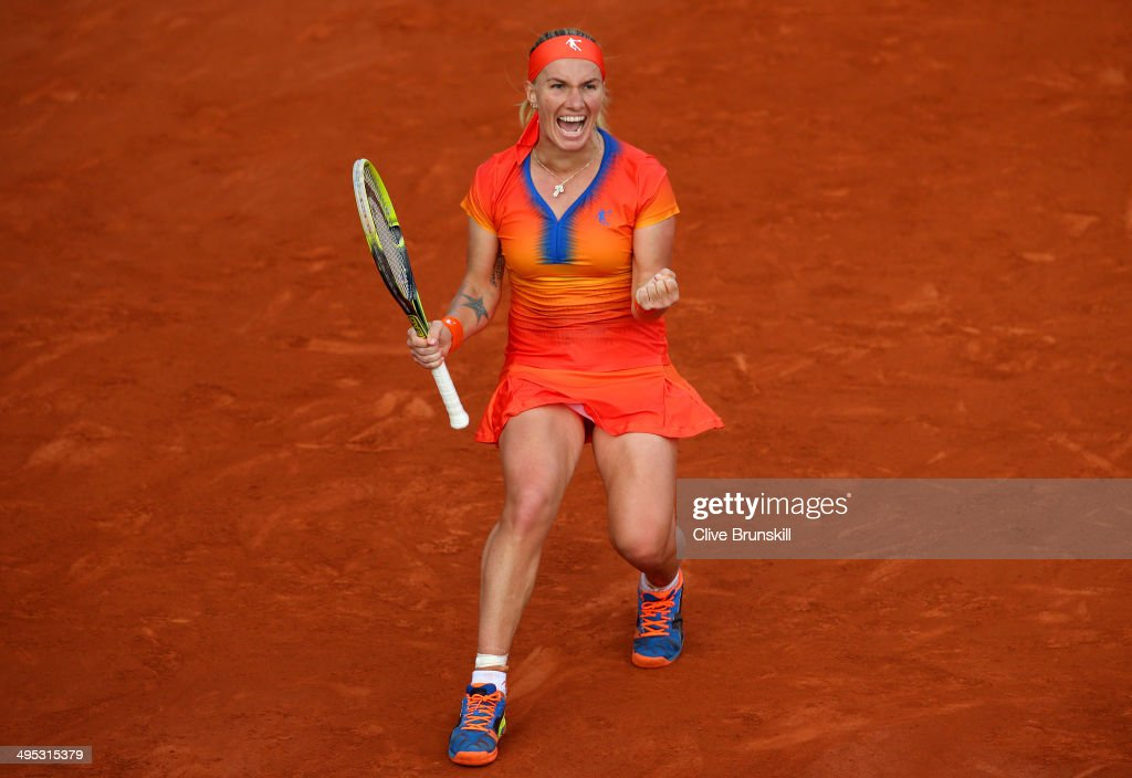 <a gi-track='captionPersonalityLinkClicked' href=/galleries/search?phrase=Svetlana+Kuznetsova&family=editorial&specificpeople=167249 ng-click='$event.stopPropagation()'>Svetlana Kuznetsova</a> of Russia celebrates victory in her women's singles match against Lucie Safarova of Czech Republic on day nine of the French Open at Roland Garros on June 2, 2014 in Paris, France.