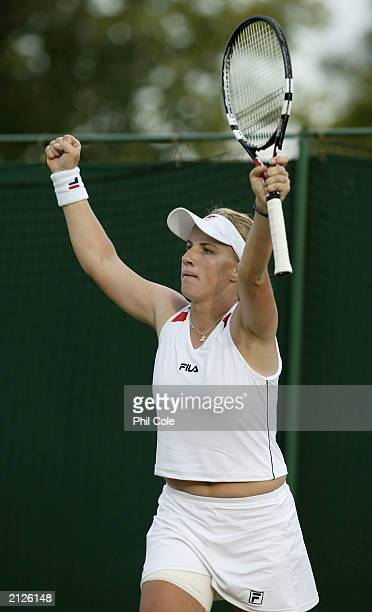 Svetlana Kuznetsova of Russia celebrates winning against returns the ball to Maria Sharapova of Russia during the fourth round of the Wimbledon...